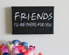 Handmade Friends TV Show Friends Logo with The Rembrandts Ill Be There For You theme song lyrics in acrylic paint on 4x6 small canvas. This canvas is perfect for the Friends TV Show lover in your life, and its mini, versatile size makes it easy to display on any table, shelf, or wall!  Canvas is ready to be hung or framed. I usually hang my canvases using command strip products as they are much less damaging to the wall, especially if you are a renter. But you can hang this canvas in…