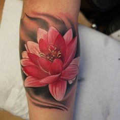 Lotus Tattoo - The lotus flower represents purification and faithfulness in Buddhism as it grows from a murky water, while rising and blooming above the murk to achieve enlightenment.