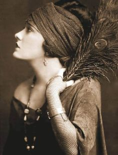 STUDIO PORTRAIT – MOVIE STAR – GLORIA SWANSON – PROFILE WITH HEAD BAND AND PEACOCK FEATHERS – BEAUTIFULLY TEXTUREDIMAGE