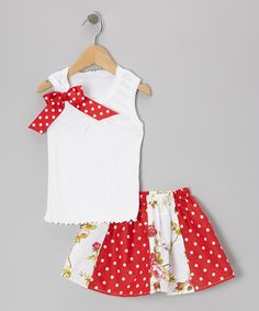 For an easy-to-wear outfit that's both sweet and stylish, look no further than this darling tank and skirt duo. Made of comfy cotton, the tank features a dainty bow at the shoulder, while the skirt's elastic waistband and mix of prints makes it both practical and precious.Includes tank and skirtCottonMachine wash; tumbl...