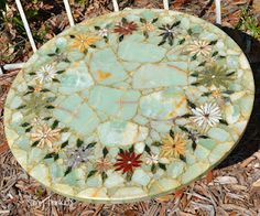 Mosaic Stone Art Tabletop - inspiration.  I have to fix a similar, but falling apart,  mosaic table top.  Love the flowers...  need to do this!