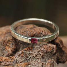 Ruby engagement ring with hammered silver band