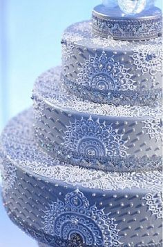 Love the design and pattern of this unique style Indian wedding cake. Love the sugar pearls! Alter the color to fit your wedding theme.