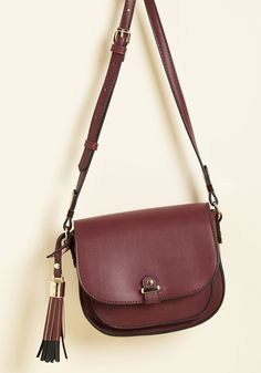 Tassel in Air Bag in Burgundy | Mod Retro Vintage Bags | ModCloth.com It's not a dream - this burgundy bag is really both effortlessly chic and endlessly useful! Created from faux leather, offering a plethora of pockets, accented with a black, fringed ornament, and touched with golden hardware, this crossbody accessory makes all your accessorizing aspirations come true.