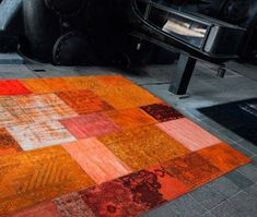 oriental rug in orange color if one of contemporary rugs inspired by patchwork fabric