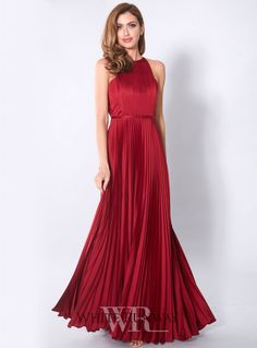 Status Gown. A stunning full length gown by Grace & Hart. A high neck style featuring pleating on the bodice and full skirt.