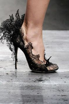 These kind of lacy, intricate black heels are crazy stunning.