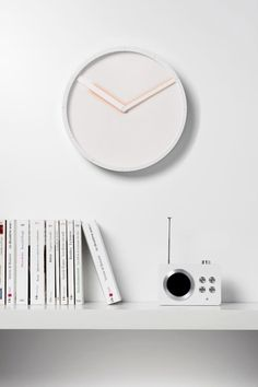 The Glow Clock was exhibited by Hallgeir Homstvedt as a prototype at SaloneSatellite in 2011, and now the clock is in production for the renowned producer Lexon. The name comes from the glow created by the contrasting color behind the hands that reflect onto the white dial of the clock.