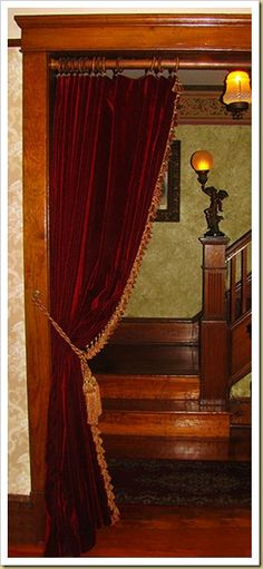 Your House Warm Using Portieres ENTER UP: Tea parlor. Velvet curtains in doorway.very popular with Victorians. Love this idea.ENTER UP: Tea parlor. Velvet curtains in doorway.very popular with Victorians. Love this idea. Victorian Curtains, Victorian Rooms, Victorian Home Decor, Victorian Parlor, Victorian Interiors, Victorian Room Divider, Victorian House, Fabric Room Dividers, Wooden Room Dividers