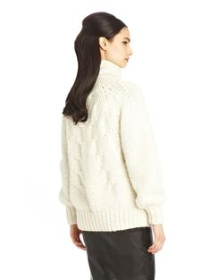 Alpaca-Blend Hand-Knit Turtleneck Sweater $2,190.00  60% alpaca / 26% silk / 14% cashmere Chunky sweaters were a reoccurring theme on the runway for Fall 2014. Here, Oscar de la Renta takes an artful approach to carefree dressing with this cable turtleneck sweater, hand-knit from the softest alpaca-silk-cashmere yarns. Take a cue from the runway by pairing with a pencil skirt and boots.