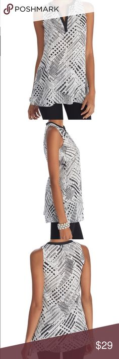 "WHBM SLEEVELESS PRINTED TIERED TUNIC TOP Sleeveless silky tunic top in modern geometric print with a luxe textured feel. Split neck with black trim gives a touch of contrast along with asymmetrical layered hem. Relaxed fit. Split neckline. Pleats from back neckline. Asymmetrical layered hem. 100% polyester. Machine wash, cold. Imported. Regular: Approximately 30"" from shoulder. White House Black Market Tops"