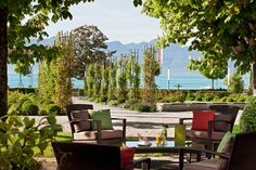 BAR with view on Lake Geneva and the Alps. Barrel aged Negronis, signature cocktails and bottle keep...