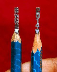 Artist makes greeting on pencil tip. Thadoju Harikrishna has been carving miniature sculptures for the last 3 years without the aid of a magnifying glass