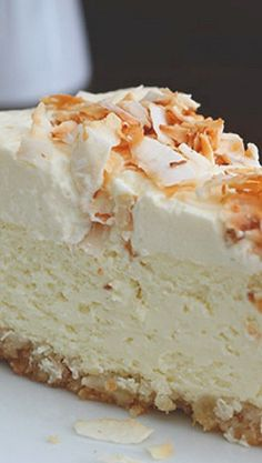Coconut Cheesecake with Macadamia Nut Crust Recipe ~ OhMyGawd! Creamy low carb coconut cheesecake with a delicious gluten-free macadamia nut crust. Desserts Keto, Just Desserts, Delicious Desserts, Dessert Recipes, Dessert Ideas, Dessert Buffet, Brunch Recipes, Coconut Cheesecake, Low Carb Cheesecake