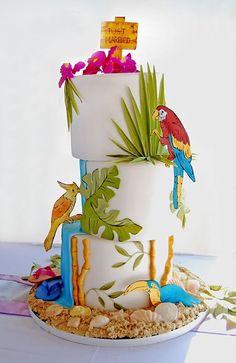 Gateaux, Inc. Omg beachy, Caribbean cake! Can't you just see this for our luau?  Or one of our beach weddings. So incredibly tacky, yet tasty.