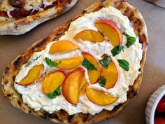 You'll want to eat this pizza for breakfast, lunch, and dessert, too. Slather ricotta on grilled dough, then top with sliced peaches, a drizzle of honey, and torn fresh basil.
