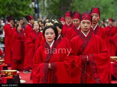 Chongqing, China. 2nd May, 2014. 52 couples married at a mass Chinese wedding that followed ancient nuptial etiquettes. Credit: Chen Cheng/Xinhua/Alamy Live News