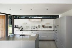 narrow window above kitchen cabinets