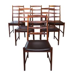 Six Arne Vodder Style Rosewood Dining Chairs | From a unique collection of antique and modern dining room chairs at https://www.1stdibs.com/furniture/seating/dining-room-chairs/