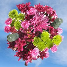 Each centerpiece is a blissful arrangement of 13 flowers. (Vase not included). Each box contains 10 marvelous centrepieces (each arrangement contains; 4 stems Lavender Mini Carnations, 2 stems of Hot Pink Alstroemerias, 1 stem of Lavender Spider Mums, 2 stems of Green Baby Blue Eucalyptus, 2 stems of Green Novelty Poms and 2 stems of Purple Cushiom Poms).