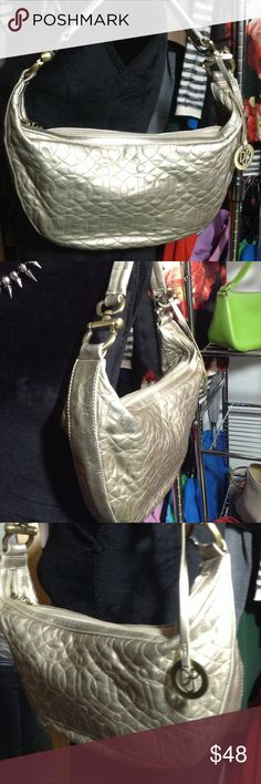 NWOT Donald j pliner hobo purse Gold Donald J pliner hobo purse. New without tags!! Donald J. Pliner Bags Hobos