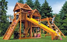 This model comes with a sandbox AND picnic table. King Kong Clubhouse Quarter Turned Package III Loaded with Wood Roofs