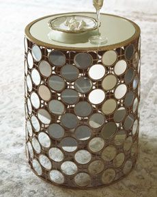 A mirrored top and mirrors all around - - great side table. Or put 2 together in lieu of a coffee table.