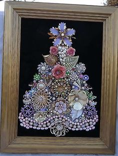 Vintage rhinestone jewelry turned into a Christmas tree Jeweled Christmas Trees, Christmas Tree Art, Christmas Jewelry, Vintage Christmas, Christmas Crafts, Christmas Ornaments, Xmas Trees, Costume Jewelry Crafts, Vintage Jewelry Crafts
