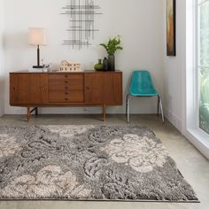 "7'7"" x 10'6"" - $272.84 Ideal for transitional spaces, and featuring plush shag styling for superior softness underfoot, this beautiful neutral area rug is machine loomed for lasting durability. In grey and taupe tones, it looks lovely in nearly any setting."