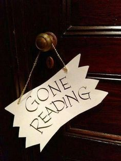 We need this bookish sign to hang up around the desks.