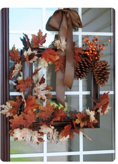 I love this!  An old picture frame and wrap some fall leaves & pinecones and berries - hang with pretty fall ribbon!