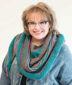 Marly's Striped Knit Shawl - Start at the center top and knit your way down to the point. As you go you will be changing stitches and colors and creating the perfect striped shawl. Choose any three shades of yarn to tailor the colors to your own look and style.