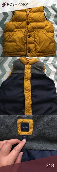 Good Condition Puffer Vest Good Condition, pre loved, kept clean, wore only one winter that was it. This is a deep mustard yellow which paired will will denim jeans or gray jeans. It is reversible with navy blue nylon and gray fleece material. It is not down, the best is filled with cotton . Which is even better for cleaning. Thanks for swinging by. Comes from a smoke free and pet free come GAP Jackets & Coats Puffers