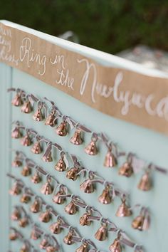 Guests found their seating assignment on these sweet bells prior to the ceremony. As the couple began their recessional, friends and family rang their bells for a melodious exit.See more vintage inspiration in our Real Weddings Gallery!Photo Credit: Beaux Arts Photographie on Kelly Oshiro via Lover.ly