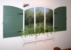 Hand Painted window and shutters on a wall...creating a view where there was none.