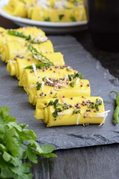 How to make Khandvi is part of Khandvi recipe - Khandvi is a popular Gujarati snack made using buttermilk and chickpea flour Here is a recipe with tips and tricks to make perfect Khandvi Indian Appetizers, Indian Snacks, Gujarati Recipes, Indian Food Recipes, Gujarati Cuisine, Gujarati Food, Maharashtrian Recipes, Vegetarian Snacks, Healthy Snacks
