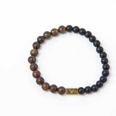 Accessories for the modern man who pays attention to details. Men's beaded bracelet with white bronzite & black matte onyx beads.