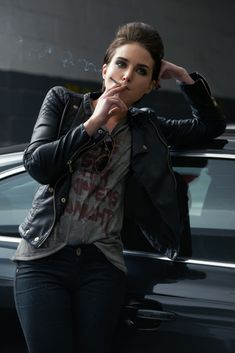 Shot of a rebellious looking young woman smoking a cigarette in a car garage Smoking Ladies, Girl Smoking, Girls Smoking Cigarettes, Cigarette Aesthetic, Smoke Pictures, Leder Outfits, Lady L, Sexy Photography, Girls World