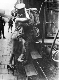 Konigstein, Germany September 23, 1929.A British Tommie bestows a last kiss upon his Rhineland sweetheart as his detachment leaves for England as they evacuate Germany.