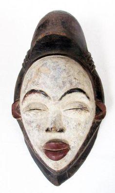 Arte africana: Mascara da etnia Punu, em madeira entalh..