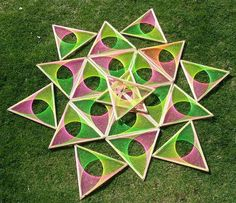 crazy patterns made fron string and shapes of wood. Could hand a load of these from the catinery system then light them with black light.