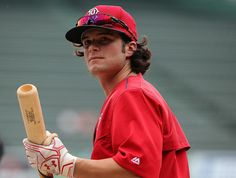 Andrew Benintendi Photos Photos - Andrew Benintendi #40 of the Boston Red Sox prepares to take batting before a game against the New York Yankees at Fenway Park on August 10, 2016 in Boston, Massachusetts. - New York Yankees v Boston Red Sox