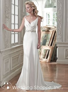 A simple satin wedding dress with plunging back.