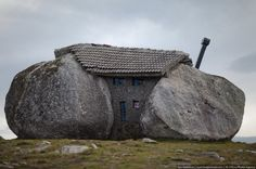 Stone - House  Portugal ... Talk about living between a rock and a hard place...
