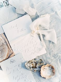 Photography: Sally Pinera - sallypinera.com Calligraphy: The Little North Sea Studio - thelittlenorthseastudio.com Styling: Kelly Oshiro Design - kellyoshirodesign.com Read More on SMP: http://www.stylemepretty.com/2016/01/19/coastal-winter-white-wedding-inspiration/