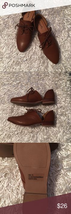 Brown cutout oxfords Never worn!  NWOT.   Very cute on.  Fits true to size for 8.5 Cupid Shoes Flats & Loafers