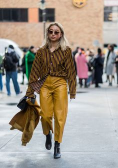 STYLECASTER | 25 Ways to Wear a Monochromatic Outfit | Mustard Yellow Pants and Stripped Top