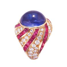 Illario Sapphire Diamond Ruby Gold Cocktail Ring   From a unique collection of vintage cocktail rings at https://www.1stdibs.com/jewelry/rings/cocktail-rings/