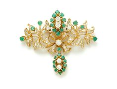 EMERALD AND DIAMOND BROOCH.  European, 20th century. 18k yellow gold with round diamonds approx. 4.0ct tw, I-J color, SI1 clarity, and round emeralds approx. 2.0ct tw, semi-opaque medium to light green color. Sold at Garth's Auctions on December 9, 2015 for $1, 560.