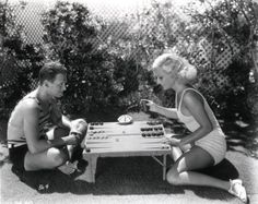 Joan Crawford playing backgammon with her first husband Douglas Fairbanks Jr